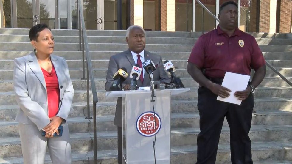 South Carolina State University President James Clark, center, spoke to reporters about an...
