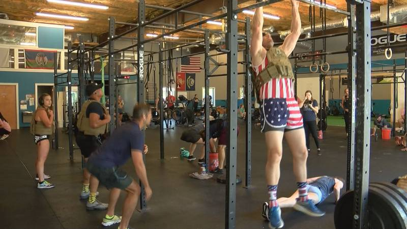 Members of the Down Home CrossFit & Fitness Center participate in the Murph Challenge for...