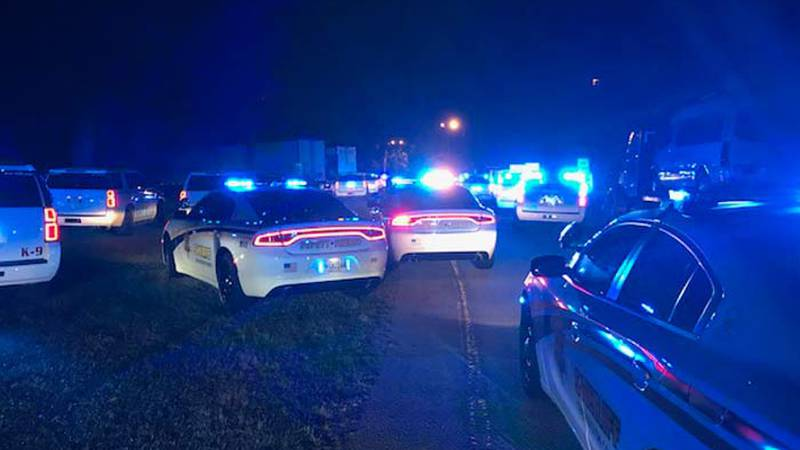 At least 20 law enforcement vehicles gathered at a rest stop along I-26 early Friday morning.