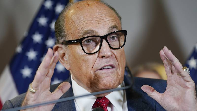 FILE - In this Nov. 19, 2020, file photo, former New York Mayor Rudy Giuliani speaks during a...