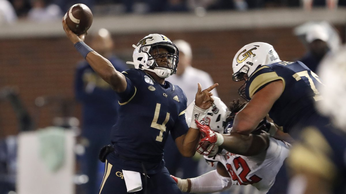 Georgia Tech quarterback James Graham (4) throws under pressure from North Carolina State...