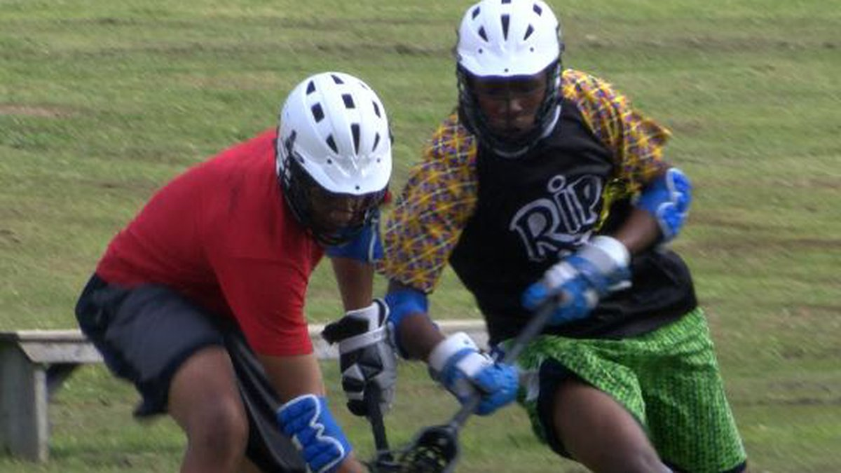 Two Johnson players fight for the ball during Monday's practice.