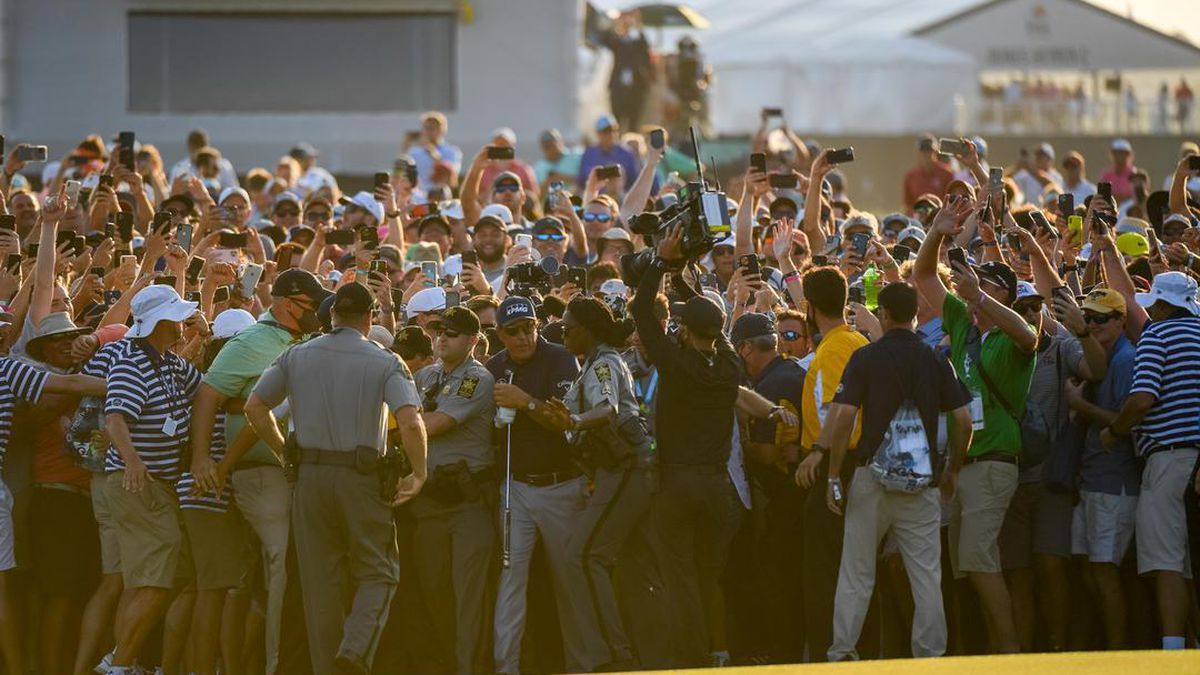 Phil Mickelson walks toward the 18th green during the final round of the 2021 PGA Championship...