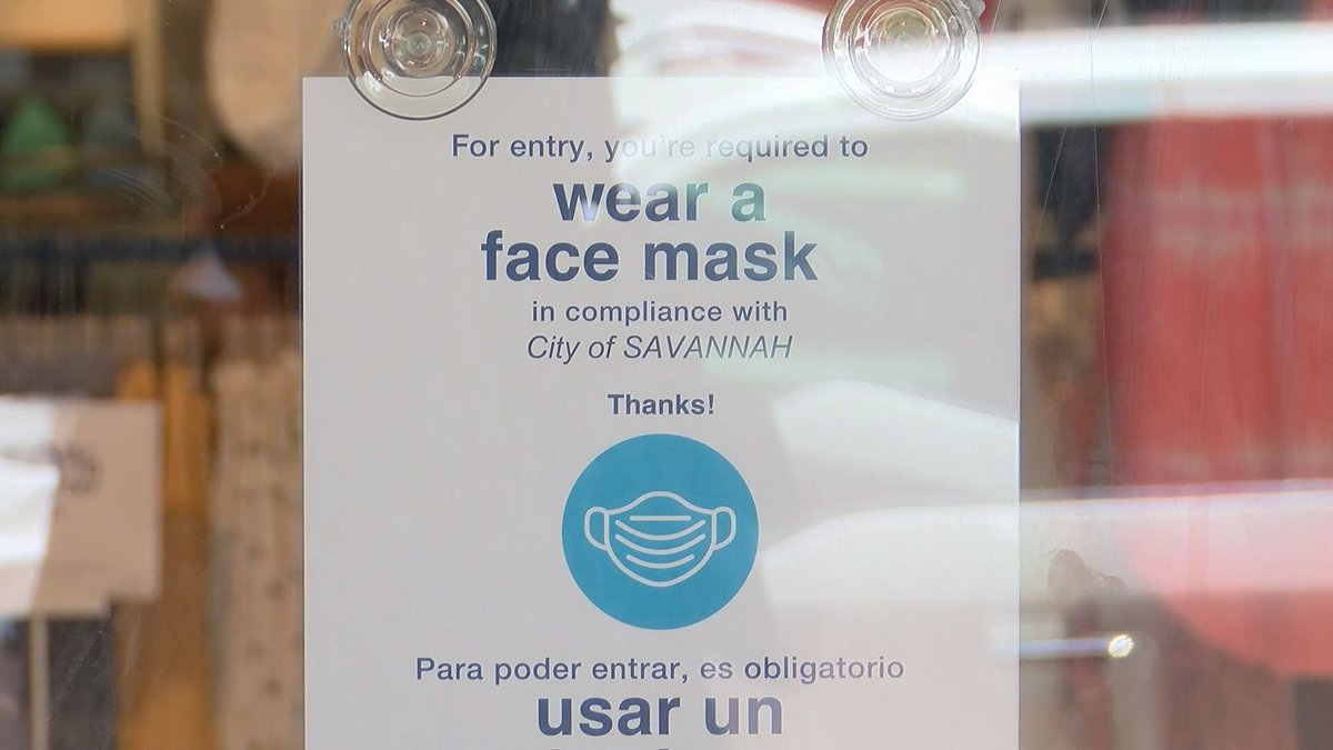A sign telling customers to wear a mask in compliance with the new ordinance in Savannah.