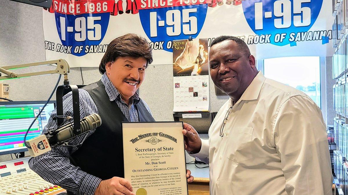 Don Scott (left) receiving the Outstanding Georgia Citizen Award for exemplary community...