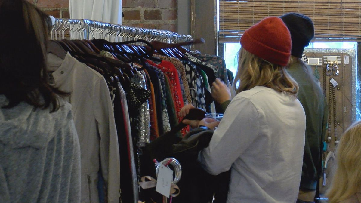 People browse through the selections offered at Cohen's Retreat pop-up party.
