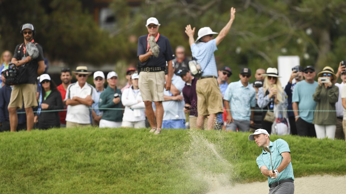 Russell Henley plays a bunker shot on the 18th hole during the third round at the 2021 U.S....