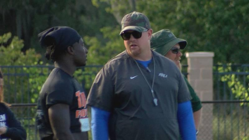 Savannah State Head Football Coach Shawn Quinn talks with a prospect at his Friday Night Lights...
