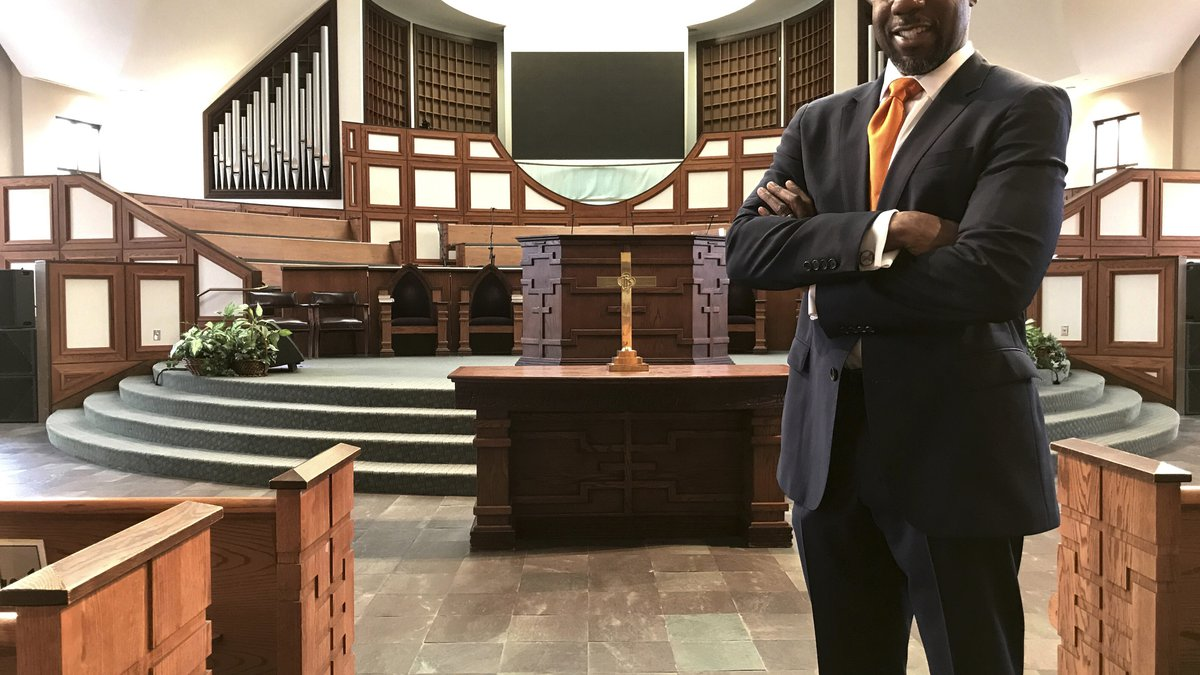 In this Thursday, Jan. 11, 2018 photo, the Rev. Raphael Warnock stands in the sanctuary of...