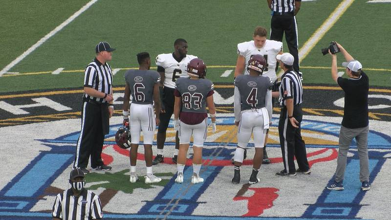 Benedictine and Wayne County flip the coin ahead of their game.