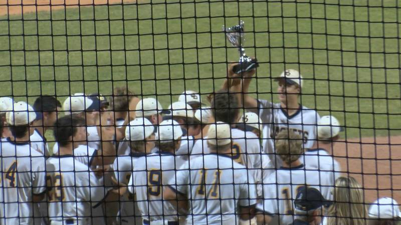 The Jeff Davis Yellow Jackets hoist their championship trophy, after sweeping Lovett for the...