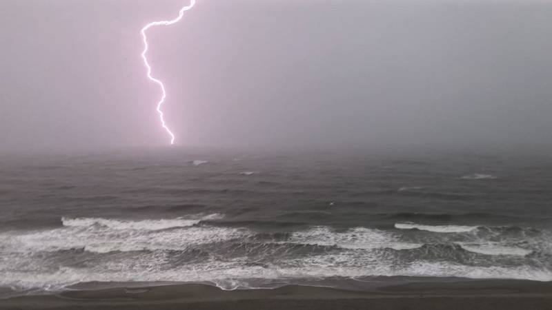 FILE - Lightning was seen offshore Thursday morning during Tropical Storm Elsa.