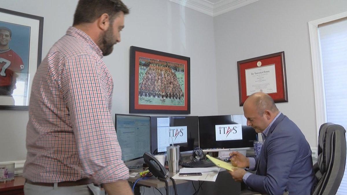 James Rahal and Adam Exas discuss business.