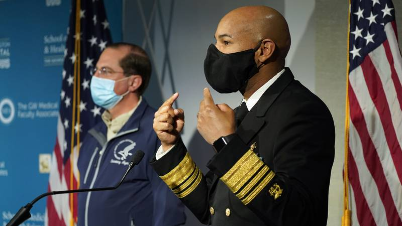 U.S. Surgeon General Dr. Jerome Adams talks about the need to still wear face masks as he...