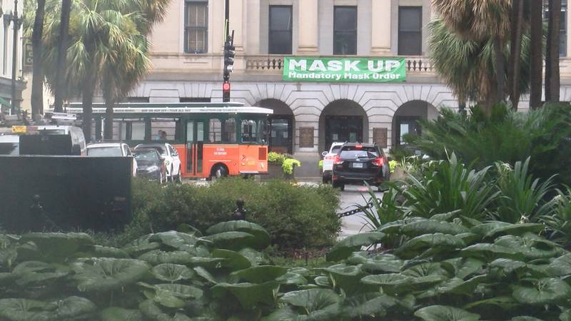 """The """"Mask Up"""" banner has returned to City Hall in Downtown Savannah."""