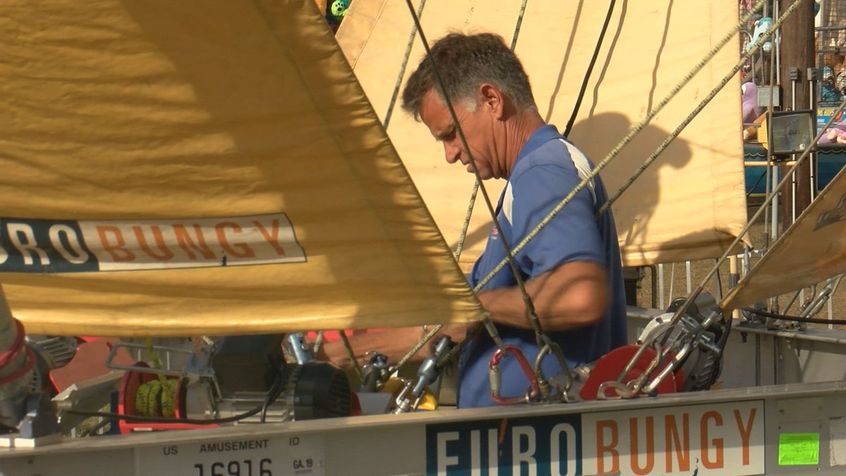 A fair worker looking over a carnival ride in Effingham County.