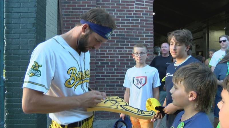 Tristan Peters signs autographs for fans in his final game for the Savannah Bananas.