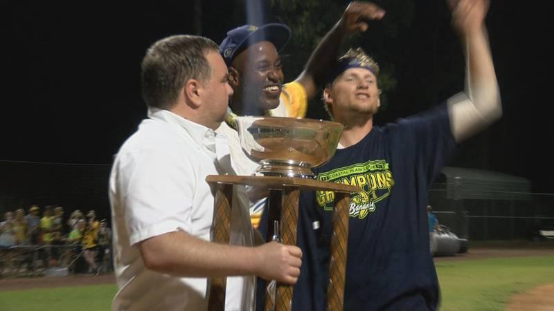 Reggie Horton (Center) holds the Petitt Cup