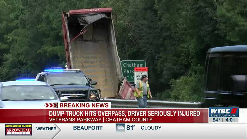 Driver injured after dump truck hits overpass on Veterans Parkway