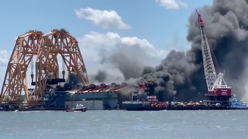Capsized ship Golden Ray on fire in the St. Simons Sound