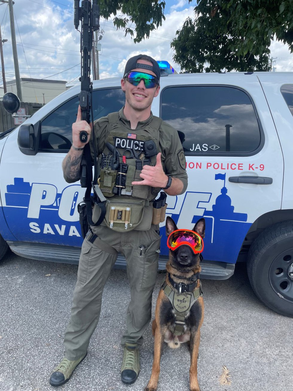 A candid moment between K-9 Jas and Savannah Police Officer Jon Lindsey.