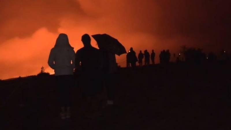Kilauea visitors watch the volcanic eruption Wednesday evening.