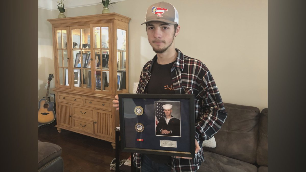 Mason Walters holds a picture of his cousin, 21-year-old Cameron Walters. Walters was one of...