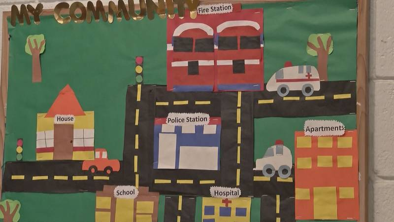 An image of a bulletin board in a daycare facility.