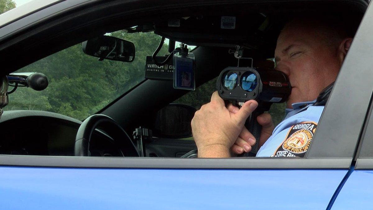 A Georgia State Patrol trooper clocks speeders on a busy interstate.