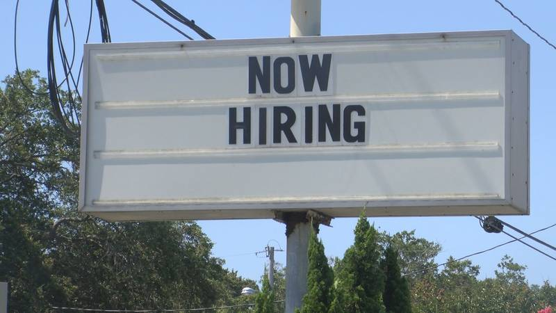 """The words """"now hiring"""" visible on a sign on Tybee Island."""
