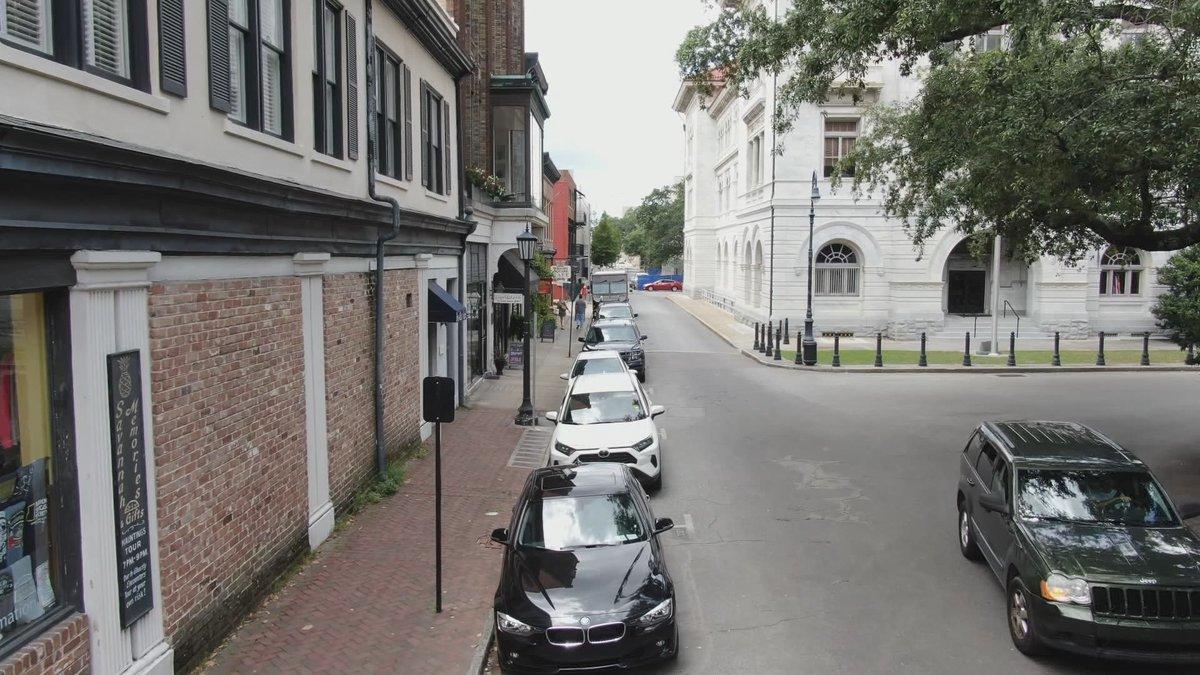 Cars parked along a downtown Savannah street.