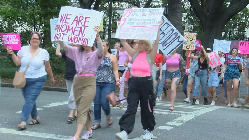 Protesters took to the streets of Savannah Tuesday to rally against recent abortion laws passed...