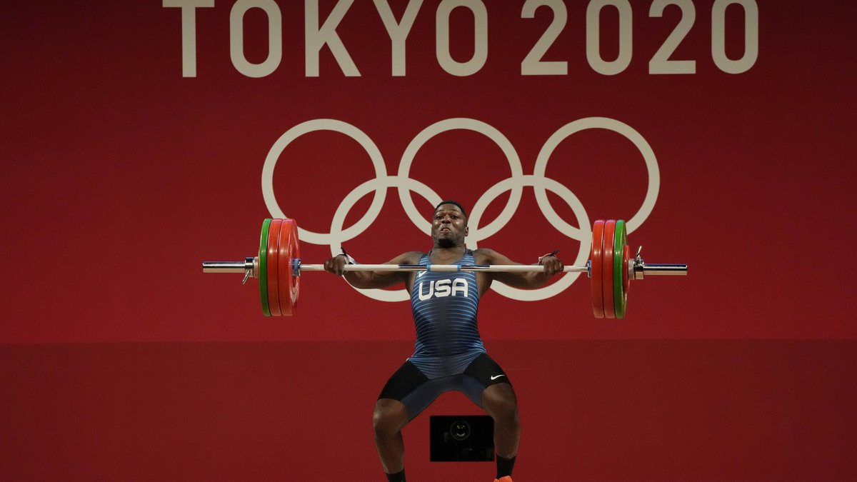 Clarence Cummings JR of the United States competes in the men's 73kg weightlifting event, at...