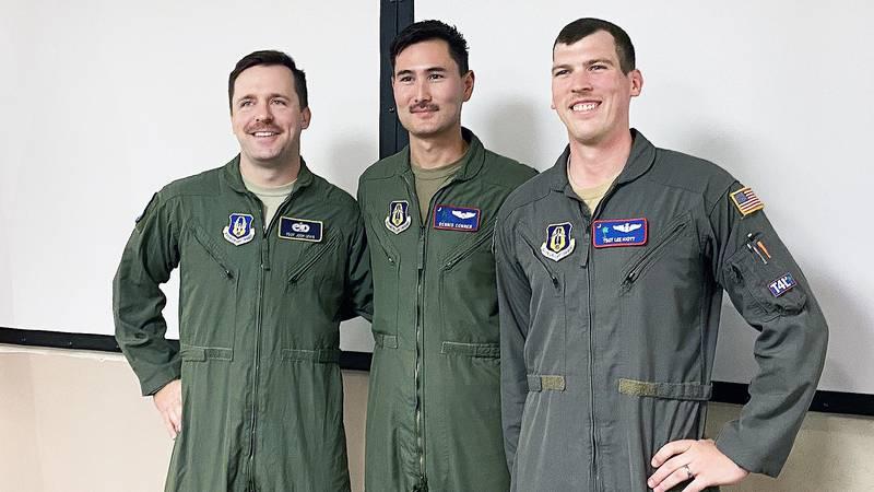Capt. Dennis Conner, a C-17 pilot in the 701st airlift squadron,  Tech Sgt. Lee Hiott, a...