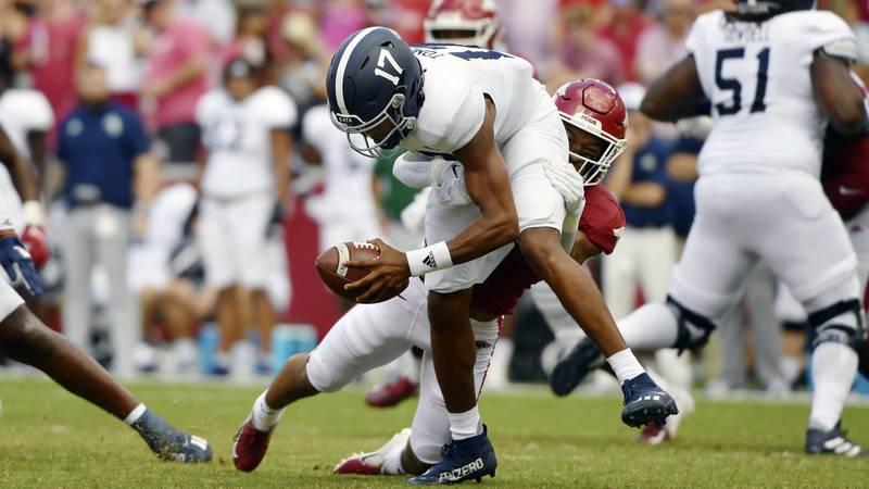 Georgia Southern quarterback Justin Tomlin (17) is tackled by Arkansas Greg Brooks Jr. (9)...