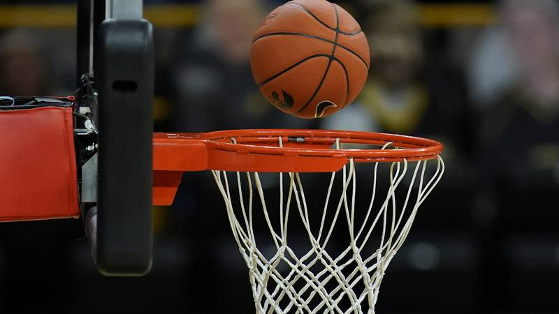 A basketball bounces off the rim during the first half of an NCAA college basketball game...