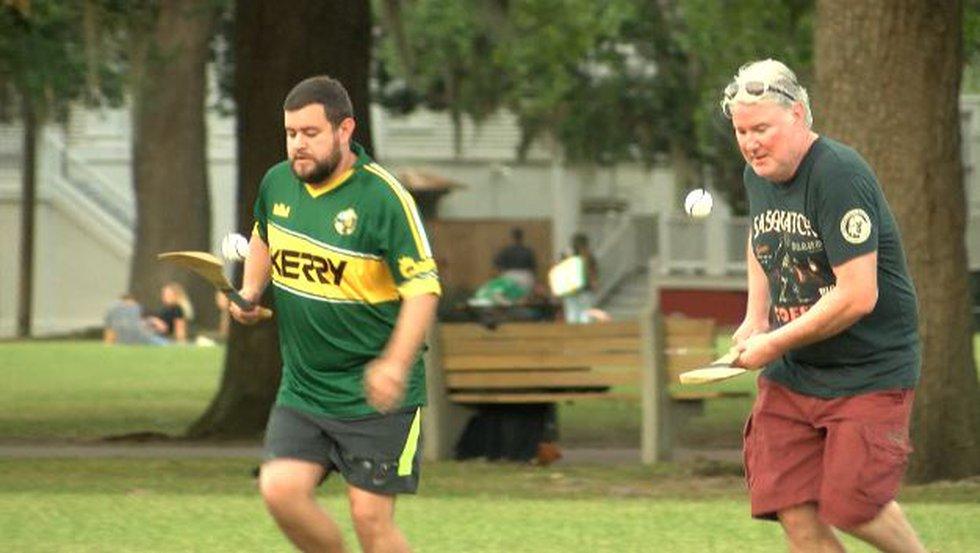 Savannah GAA co-founders Caleb Harkleroad (L) and Damien Shields demonstrate hurling.