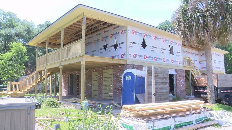 A Burnside Island family is raising their home after it flooded during Hurricane Irma.
