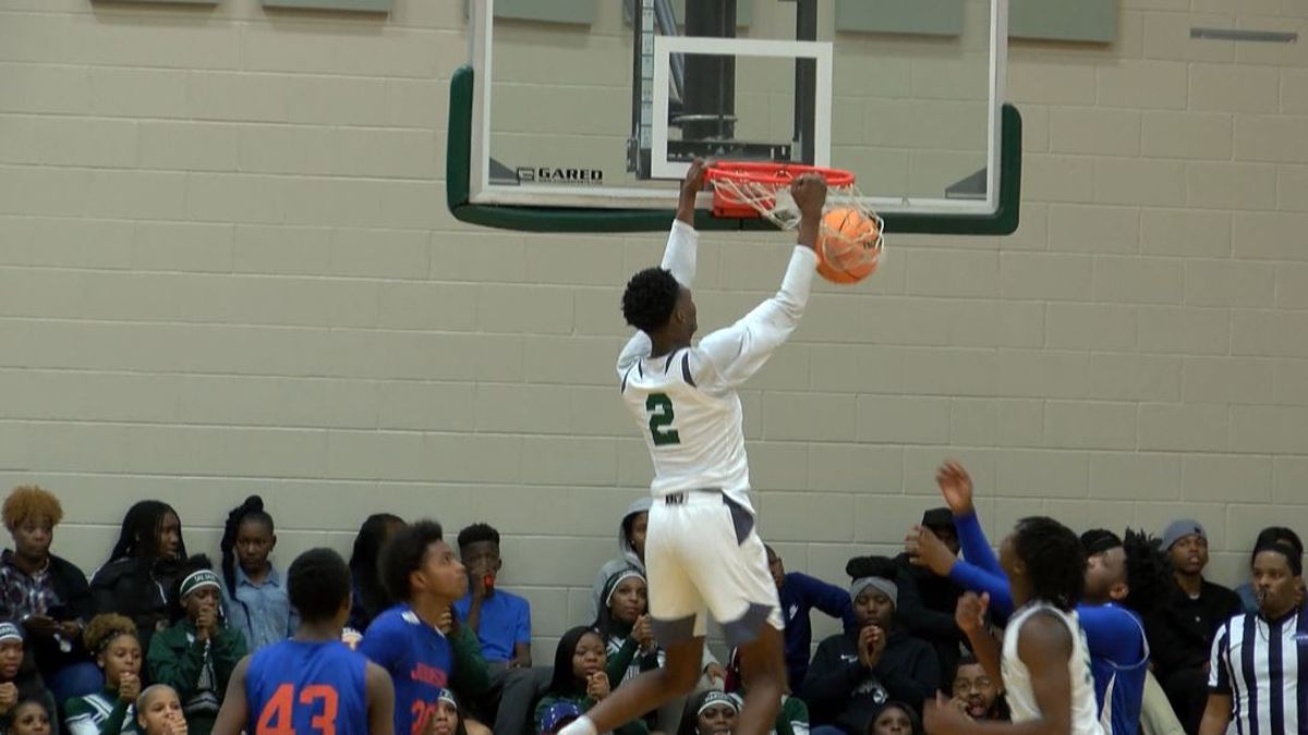 Windsor Forest's D'Ante Bass dunks home an offensive rebound during the Knights' 69-60 win.