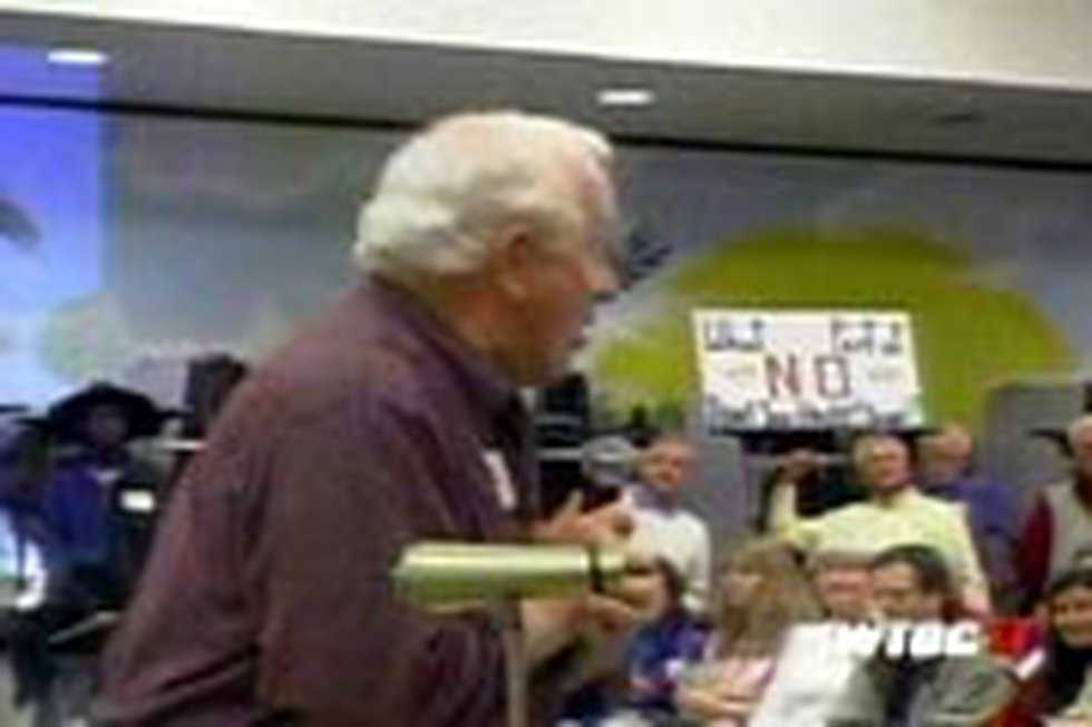 Many took the microphone to speak against the proposed annexation.