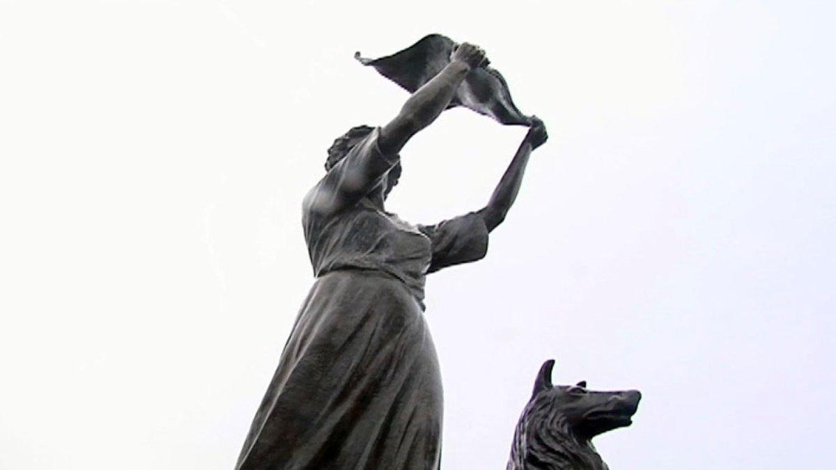 The Waving Girl Statue sits along the Savannah River.