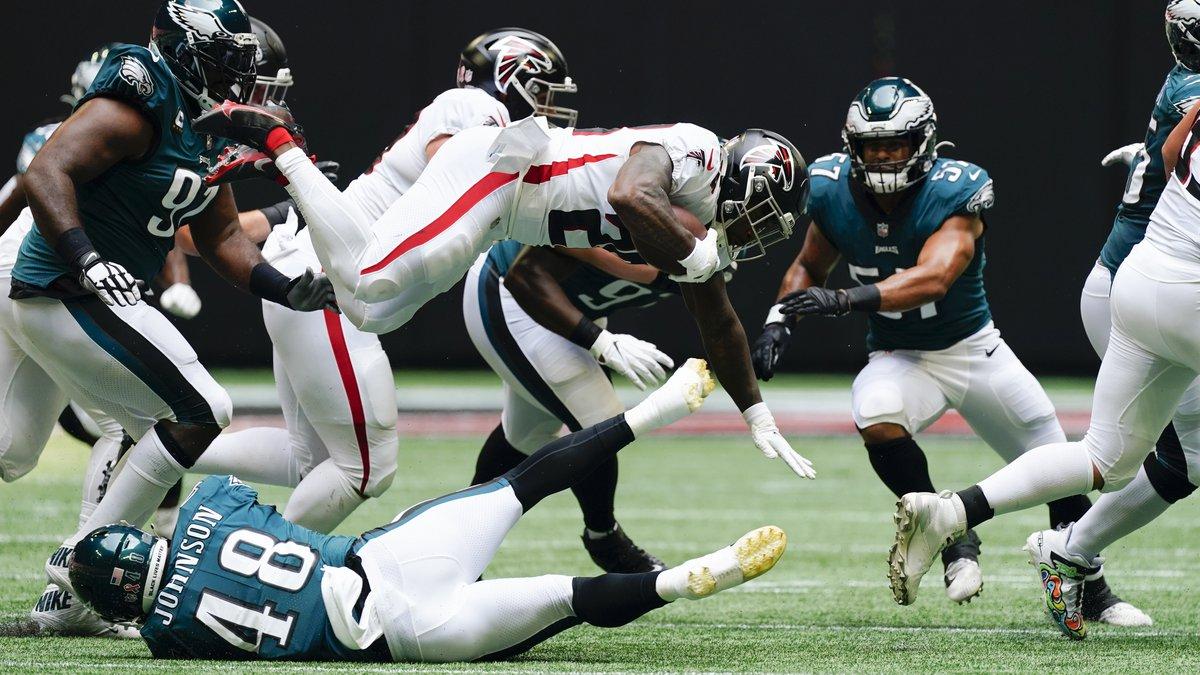 Atlanta Falcons running back Mike Davis (28) leaps in the air against the Philadelphia Eagles...
