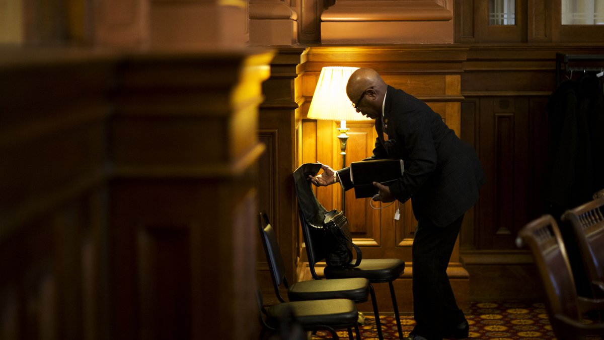 Georgia Rep. Mickey Stephens, D - Savannah, packs up after the House went into recess at the...