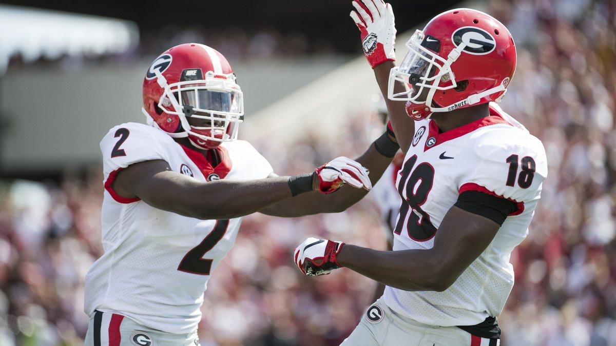 Georgia defensive back Deandre Baker (18) and Richard LeCounte (2) celebrate a defensive play...