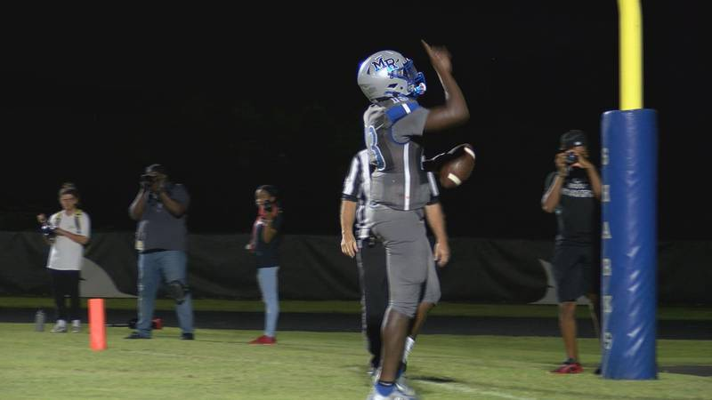 May River Sharks senior quarterback Garvin Douglas after scoring on a two-point conversion...