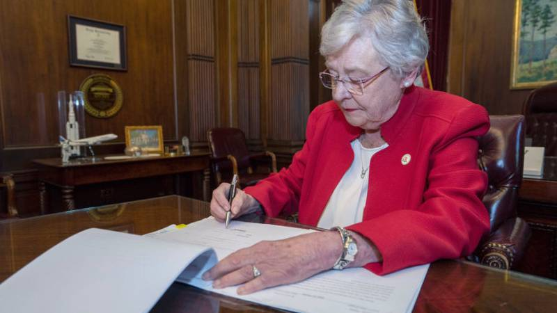 Alabama Gov. Kay Ivey signed the state's near-total abortion ban bill into law Wednesday, the...