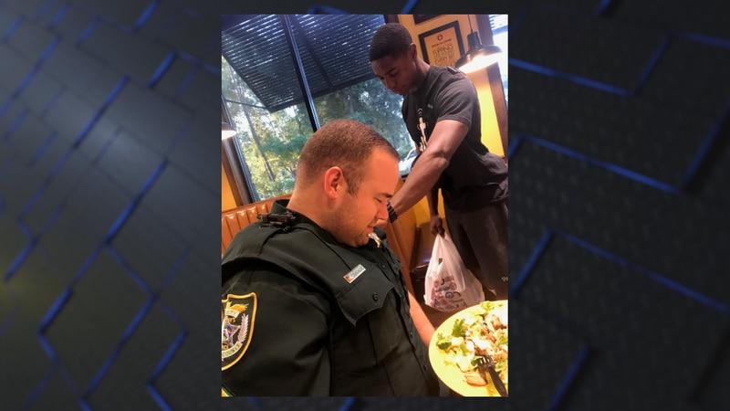 Juan O'Neal and Deputy Cameron Tucker as seen in viral photo