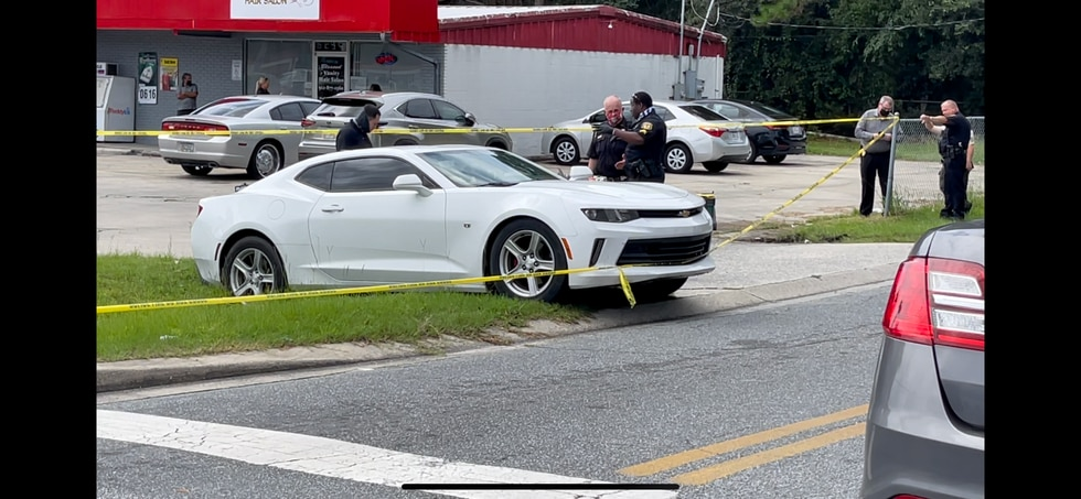The shooting happened at the corner of Palm Drive and E.G. Miles Parkway.